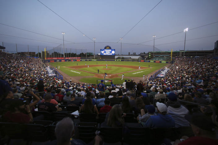 Fans watch the sixth inning of a baseball game between the Toronto Blue Jays and Boston Red Sox on Wednesday, July 21, 2021, in Buffalo, N.Y. (AP Photo/Joshua Bessex)