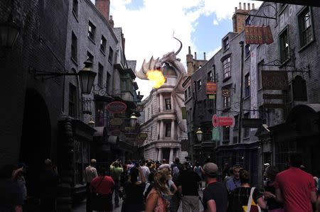 A dragon breathes fire above The Wizarding World of Harry Potter-Diagon Alley during a media preview at the Universal Orlando Resort in Orlando