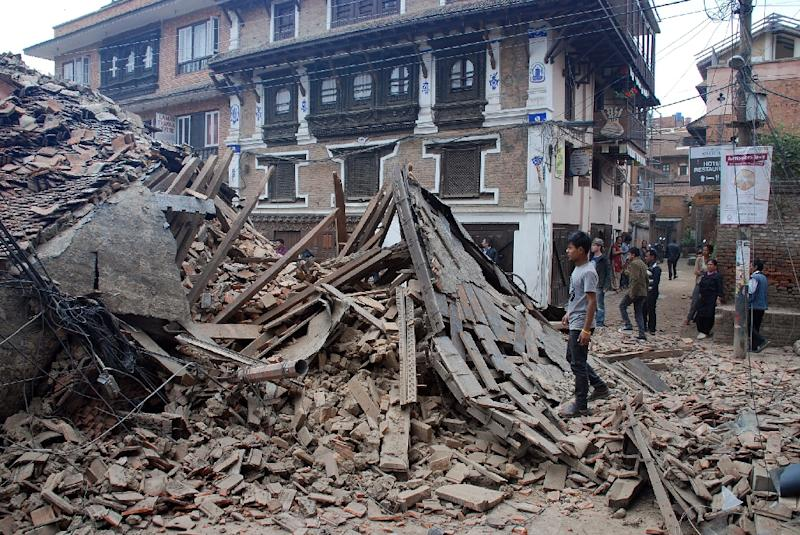Photo taken on April 25, 2015 and released to AFP on April 26 by Caritas Australia, the international aid and development agency of the Catholic Church, shows a collapsed building in Kathmandu (AFP Photo/Edyta Stepczak)
