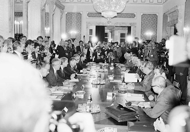 <p>View over the conference table inside the Soviet Embassy shows at the left side the American and at right the Soviet delegation, Sunday, June 17, 1979, Vienna, Austria. Pres. Jimmy Carter, third from left, is flanked by Secretary of State Cyrus Vance and Advisor Zbigniew Brzezinski; Soviet President Leonid Brezhnev, fourth from right, is flanked by soviet Defense Minister Marshal Ustinov and his Foreign Minister Andrei Gromyko. (Photo: AP) </p>