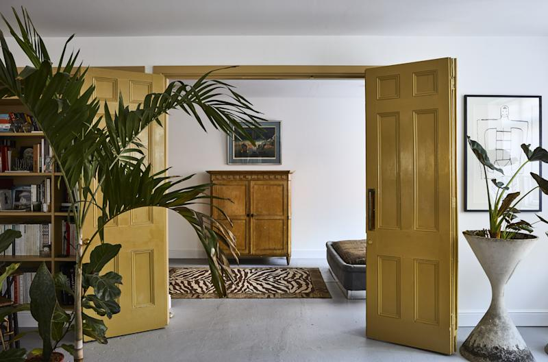 Mustard-colored interior doors add warmth and a dose of '70s flair.