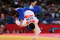Ki-Chun Wang of Korea competes against Jaromir Jezek of Czech Republic on Day 3 of the London 2012 Olympic Games at ExCeL on July 30, 2012 in London, England. (Photo by Alexander Hassenstein/Getty Images)