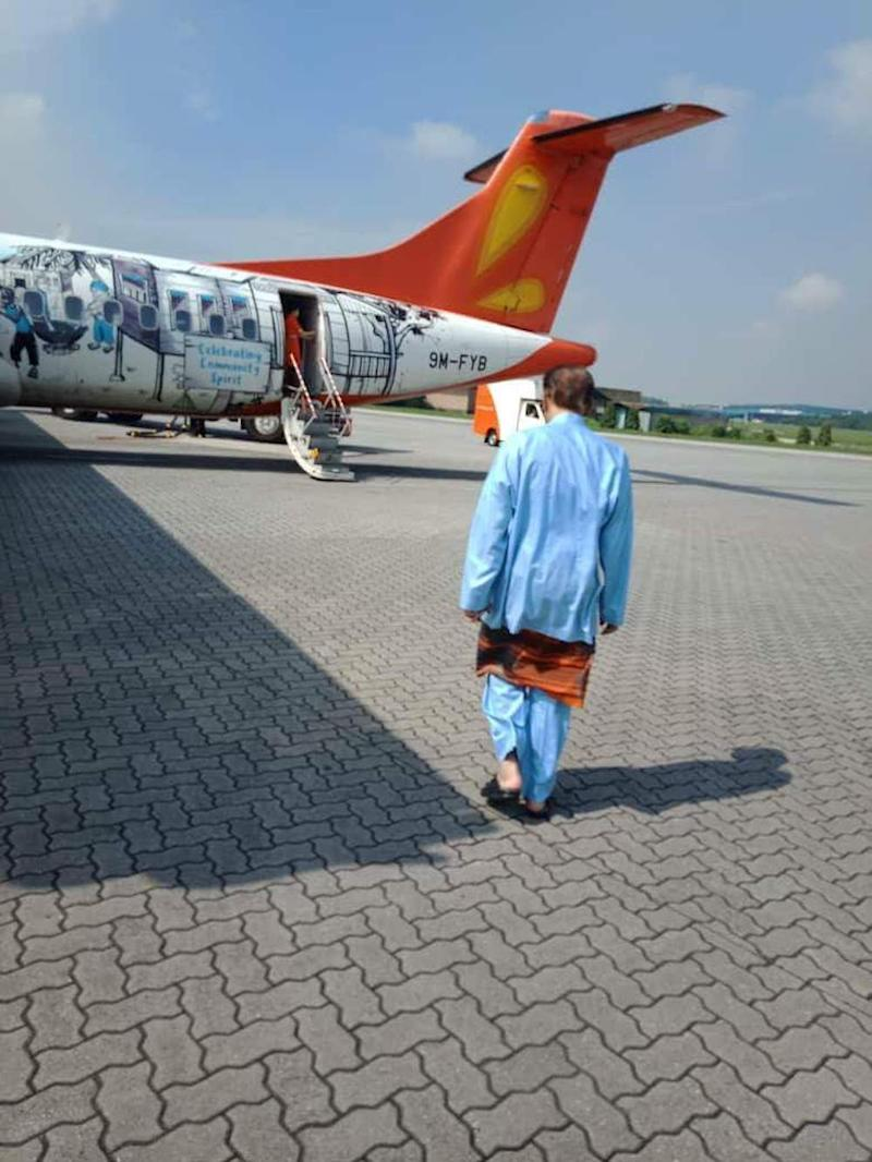 Anwar also shared this photo of him walking towards a Firefly commercial jet. — Picture via Facebook/AnwarIbrahim