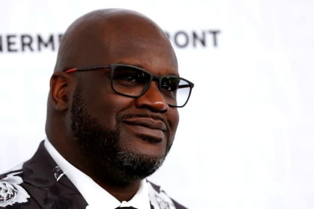 FILE PHOTO: Broadcaster and former NBA star Shaquille O'Neal poses as he arrives at the WarnerMedia Upfront event in New York