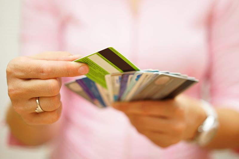 Woman holding multiple credit cards
