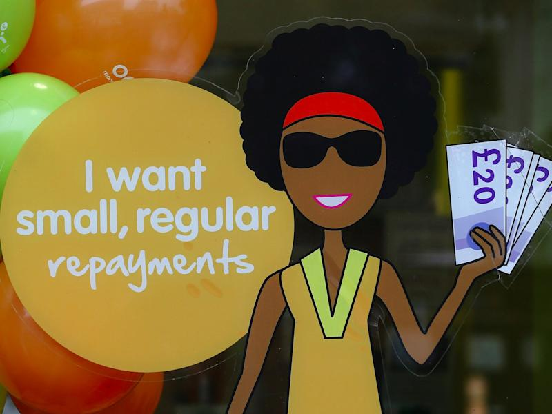 A sign in the window of a payday loans store in Dalston on October 3, 2013 in London, England. Payday loan stores are to face tougher regulations after moves proposed by the Financial Conduct Authority (FCA) call on more responsible lending. (Photo by )