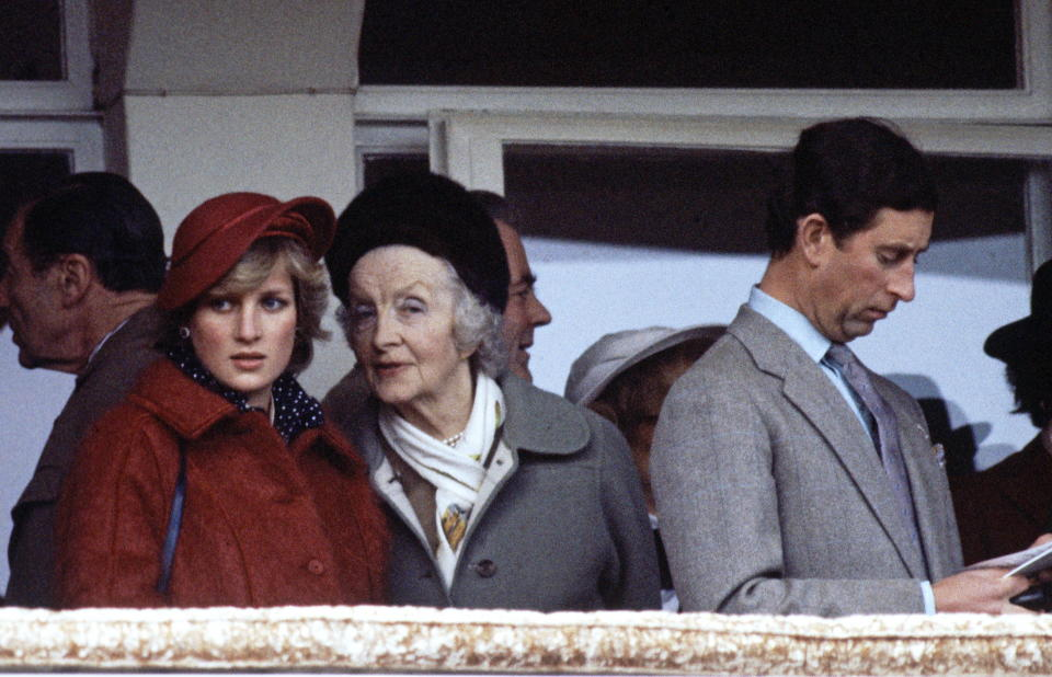 CHELTENHAM, UNITED KINGDOM - APRIL 03:  Diana, Princess Of Wales, Talking To Her Grandmother, Ruth, Lady Fermoy During The National Hunt Festival At Cheltenham.  Prince Charles Is Beside Them Reading A Racing Programme.  (Photo by Tim Graham Photo Library via Getty Images)