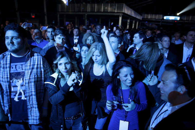 This Jan. 30, 2014 photo shows fans at a concert by The Roots in a tent next to the Bud Light Hotel in New York. The temporarily renamed hotel moored on the Hudson River, is Norwegian Cruise Line's new ship Norwegian Getaway, and is acting as a floating hotel for fans and a site for hosting Super Bowl-related events. (AP Photo)