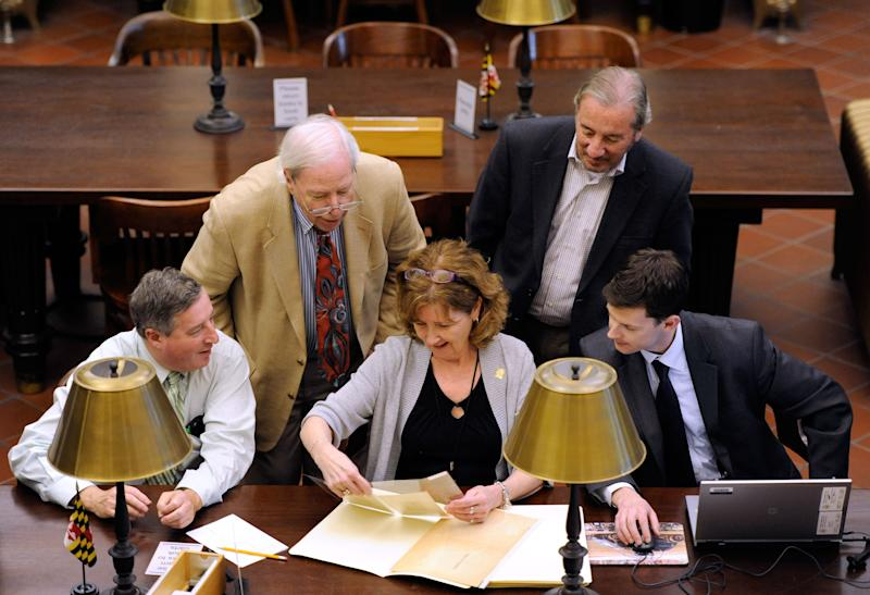 From the left, Mitch Yockelson, an investigative archivist from the National Archives and Records Administration, Burton K. Kummerow, president and chief executive officer of the Maryland Historical Society, Patricia Dockman Anderson, director of publications and library services at the Maryland Historical Society, C. Dennis Elder, chief financial officer of the Maryland Historical Society, and J. Matthew Kazlauskas, FBI special agent, look at stolen historic artifacts Monday, May 13, 2013, as the FBI returns them to the Maryland Historical Society in Baltimore. The documents were stolen from the society by Barry Landau and his assistant Jason Savedoff, who are both in prison for stealing from archives nationwide. (AP Photo/Steve Ruark)