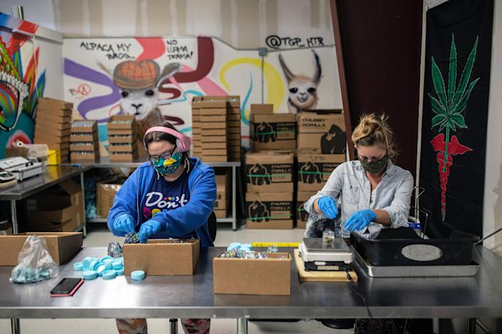 Sandi Griffin, left, and Melissa Campbell weigh and package Delta 8 products at Hometown Hero CBD in Austin, Texas, on Feb. 23, 2021. (Tamir Kalifa/The New York Times)