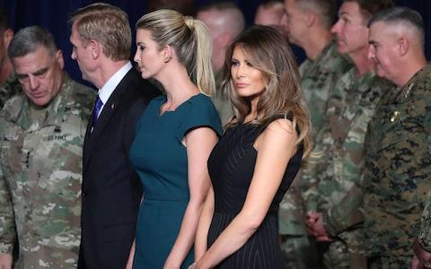 First lady Melania Trump stands with Ivanka Trump before President Donald Trump delivered remarks on American involvement in Afghanistan at the Fort Myer military base on August 21, 2017 in Arlington, Virginia - Credit: Getty