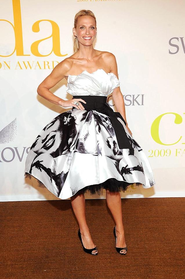 "Molly Sims made a statement in a fabulous Dolce and Gabbana cocktail frock with a Marilyn Monroe print splashed across the skirt. Jamie McCarthy/<a href=""http://www.wireimage.com"" target=""new"">WireImage.com</a> - June 15, 2009"