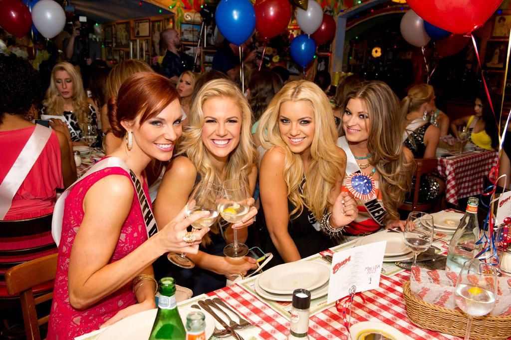 Miss South Dakota USA 2013, Jessica Albers; Miss Tennessee USA 2013, Brenna Mader; Miss Florida USA 2013, Michelle Aguirre; and Miss New Mexico USA 2013, Kathleen Danzer; enjoy the welcome dinner at Buca di Beppo in Las Vegas, Nevada on Wednesday June 5, 2013.