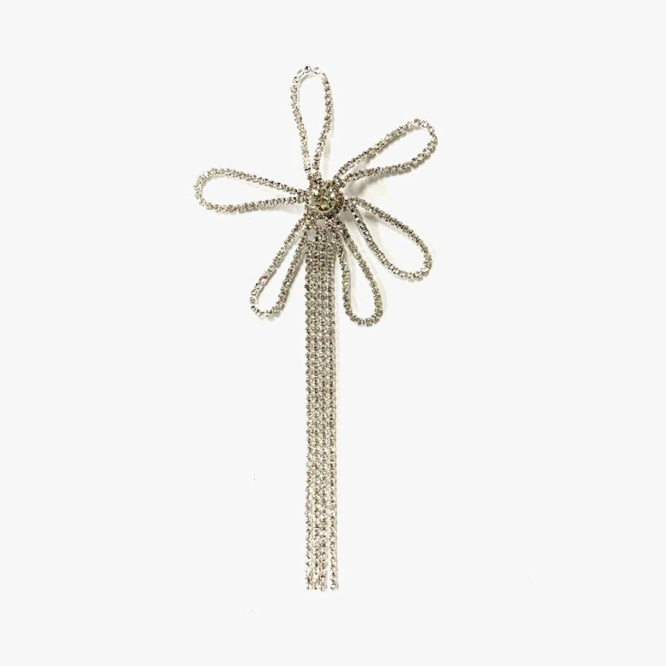 "Collina Strada's single flower chain pin makes for an exciting touch of diamanté that can instantly spice up any outfit or accessory this holiday season. $50, COLLINA STRADA. <a href=""https://collinastrada.com/collections/accessories/products/single-flower-chain-pin-1"" rel=""nofollow noopener"" target=""_blank"" data-ylk=""slk:Get it now!"" class=""link rapid-noclick-resp"">Get it now!</a>"