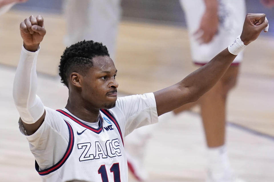 Gonzaga guard Joel Ayayi (11) reacts to a play against Creighton in the first half of a Sweet 16 game in the NCAA men's college basketball tournament at Hinkle Fieldhouse in Indianapolis, Sunday, March 28, 2021. (AP Photo/Michael Conroy)