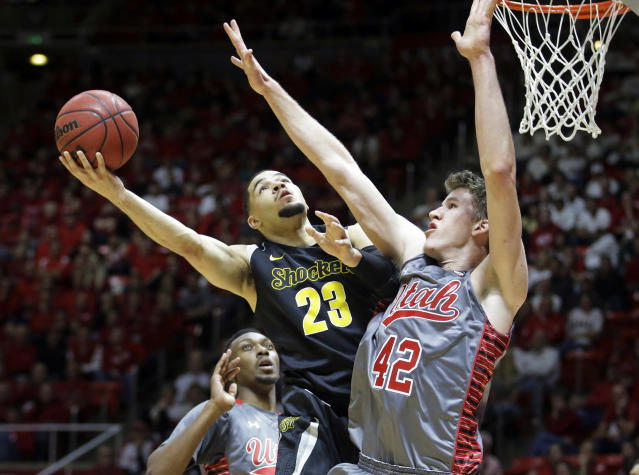 Wichita State guard Fred VanVleet (23) shoots as Utah forward Jakob Poeltl (42) defends in the second half of an NCAA college basketball game Wednesday, Dec. 3, 2014, in Salt Lake City. (AP Photo/Rick Bowmer)