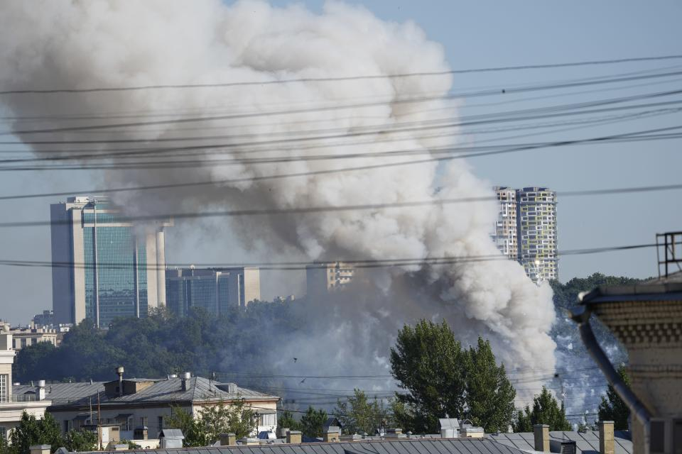 Smoke rises from a pyrotechnics warehouse in Moscow, Russia, Saturday, June 19, 2021. A large fire broke out at a fireworks depot in the center of Moscow. The fire is raging at the area of 500 square meters, Russia emergency services said in the statement. (AP Photo/Pavel Golovkin)