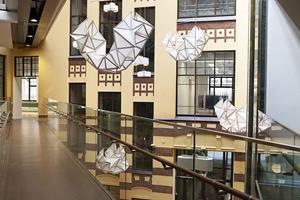 The installation is called Geo Pilvi and consists of eight folded structures that hang from the ceiling of Glasshouse Helsinki.