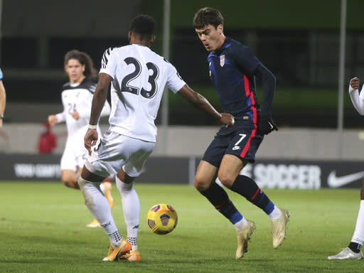 United States' Gio Reyna, right, and Panama's Michael Murillo compete for the ball during the international friendly soccer match between the USA and Panama at the SC Wiener Neustadt stadium in Wiener Neustadt, Austria, Monday, Nov. 16, 2020. (AP Photo/Ronald Zak)