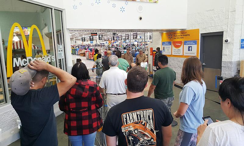People wait to enter the Walmart in Katy, Texas, on Wednesday. (David Lohr/HuffPost)