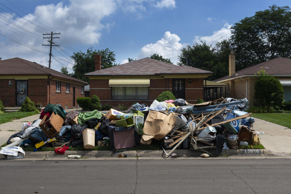 Detroit, Michigan, USA - August 20, 2014: An evicted house at a suburban street with left belongings on the lawns near the 8 mile road, in the city of Detroit.