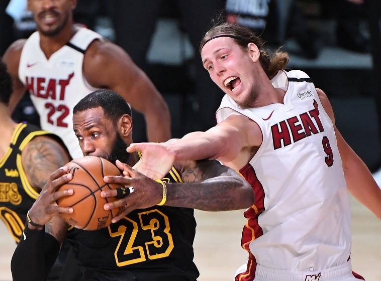 The Lakers' LeBron James grabs a rebound from Heat's Kelly Olynyk in Game 2 of the NBA Finals on Oct. 2, 2020.