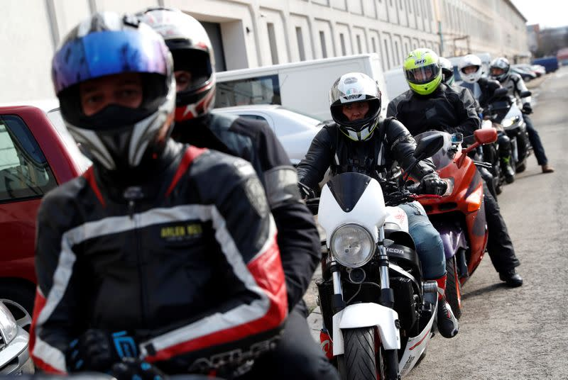 Members of the 'Easy Riders', a Hungarian bikers group, gather to help a domestic violence victim in Budapest