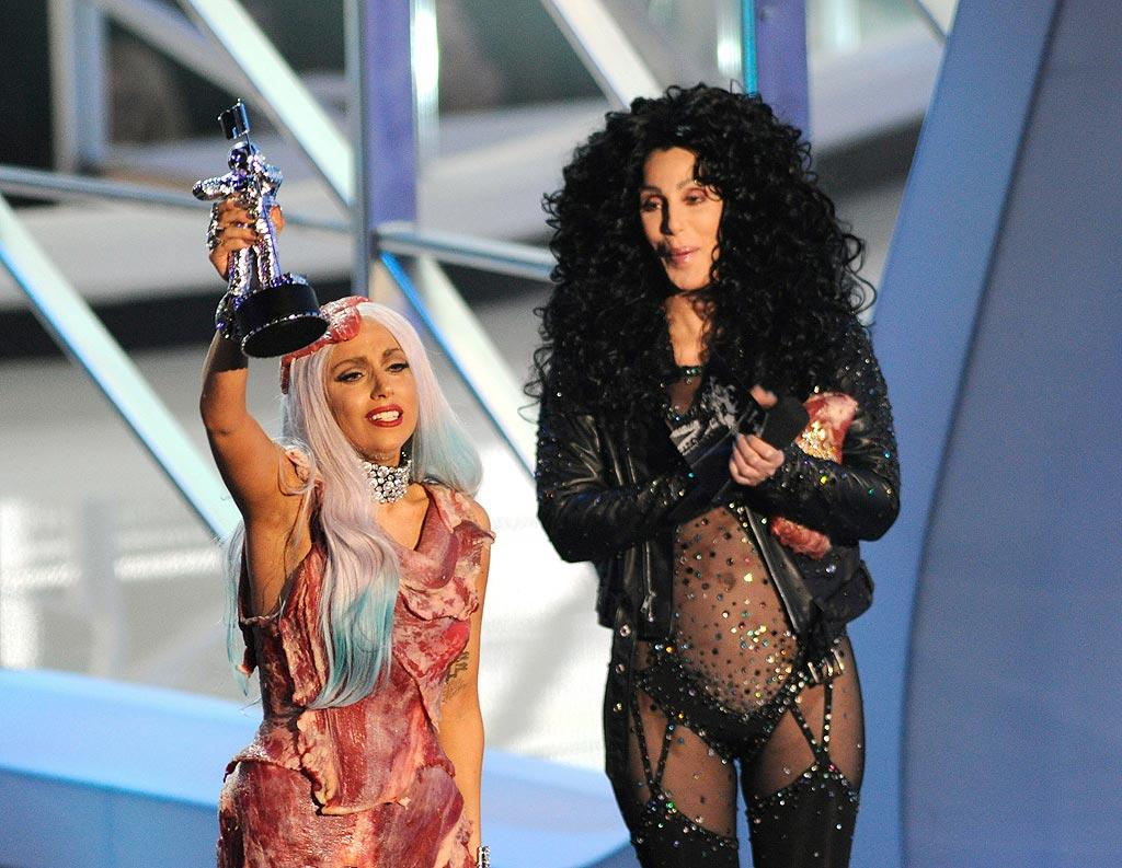 "In one of the more interesting moments at the MTV VMAs on Sunday, Lady Gaga outraged PETA when accepted her award for Video of the Year wearing a gown made of raw meat. Even better was the skimpy ensemble Cher, 64, dug out of the back of her closet for the ceremony, which she rocked 20 years ago in her racy ""If I Could Turn Back Time"" video! Kevin Mazur/<a href=""http://www.wireimage.com"" target=""new"">WireImage.com</a> - September 12, 2010"