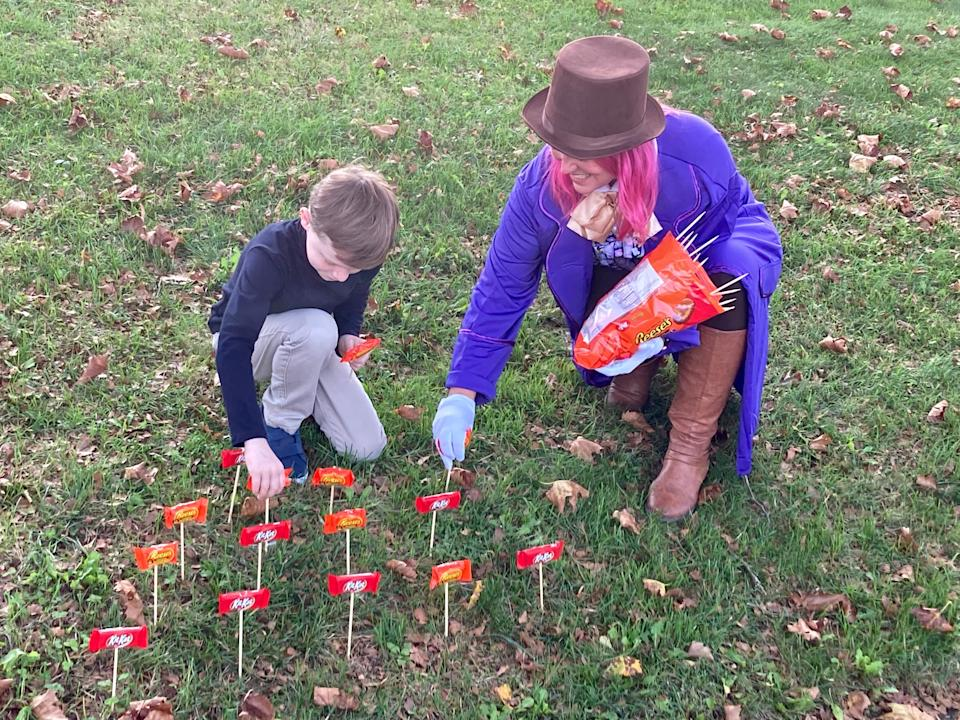Lynn Rutecki and son, Jake, are planting a candy garden to match their Halloween costume theme of Willy Wonka and the Chocolate factory outside their Middletown, Penn., home.