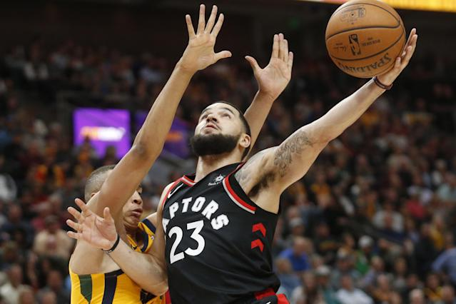 Toronto Raptors guard Fred VanVleet (23) lays the ball up as Utah Jazz guard Dante Exum, left, defends in the second half during an NBA basketball game Monday, Nov. 5, 2018, in Salt Lake City. (AP Photo/Rick Bowmer)