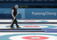 <p>A man sweeps the sheets before the start of the curling mixed doubles semi-final match at the 2018 Winter Olympics in Gangneung, South Korea, Monday, Feb. 12, 2018. (AP Photo/Aaron Favila) </p>
