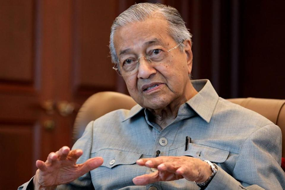 Former prime minister Tun Dr Mahathir Mohamad today said that he is fine with party hoppers but lamented that what befell Pakatan Harapan (PH) was a concerted move to bring the 22-month-old government down. — Reuters pic