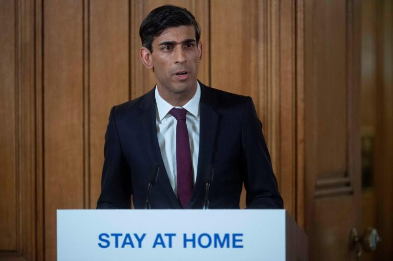 British PM Johnson holds a news conference with Chancellor of the Exchequer Rishi Sunak and Deputy Chief Medical Officer Dr Jenny Harries on coronavirus in London