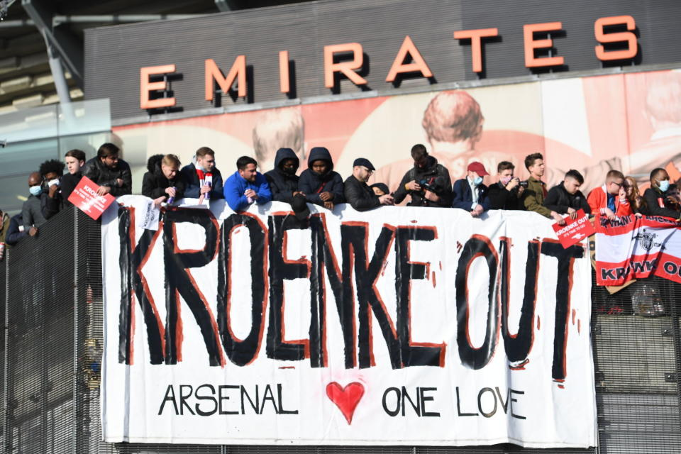 Fans protest against Arsenal owner Stan Kroenke before the English Premier League match against Everton, at the Emirates Stadium in London, Friday April 23, 2021. The fans want owner Stan Kroenke to leave the club over its bid to join the failed Super League. (Kirsty O'Connor/PA via AP)