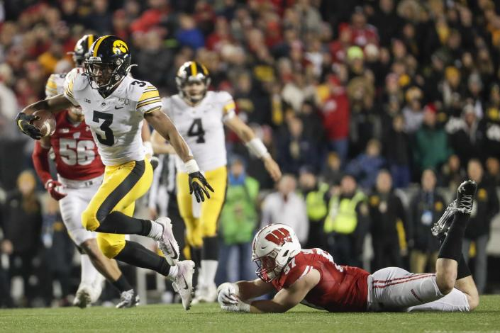 Iowa's Tyrone Tracy Jr. gets past Wisconsin's Jack Sanborn during the second half of an NCAA college football game Saturday, Nov. 9, 2019, in Madison, Wis. Wisconsin won 24-22. (AP Photo/Morry Gash)