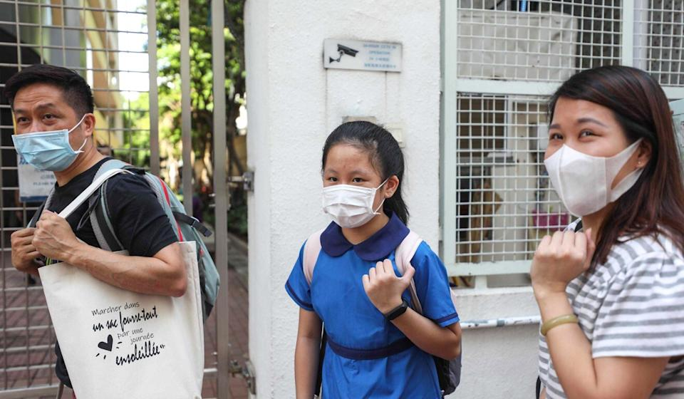 A student surnamed Chan, accompanied by her parents, arrives at David Li Kwok Po College in Yau Ma Tei to see if she can get a place after not being satisfied with her school allocation. Photo: Xiaomei Chen