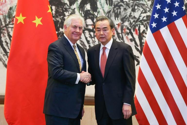 China's Foreign Minister Wang Yi (right) shakes hands with US Secretary of State Rex Tillerson after a joint press conference in Beijing, on March 18, 2017