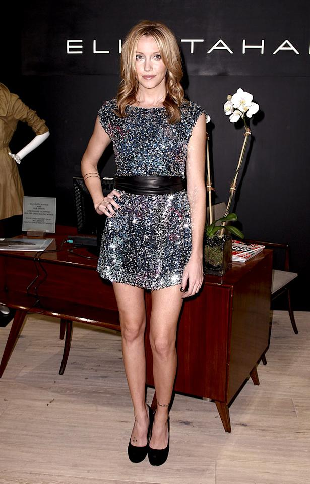 "Sparkles are all the rage this fall and Katie Cassidy is clearly a fan of the trend. The former ""Melrose Place"" minx stole the spotlight in a sequined Elie Tahari stunner at the grand opening of the designer's NYC boutique. Brian Ach/<a href=""http://www.wireimage.com"" target=""new"">WireImage.com</a> - October 19, 2010"