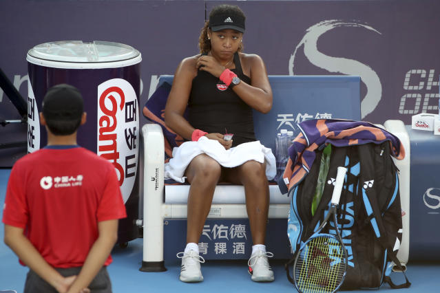 Naomi Osaka of Japan rests between points during a second-round match against Danielle Collins of United States at the China Open Tennis tournament in Beijing, China, Tuesday, Oct. 2, 2018. Osaka beat Collins 6-1, 6-0. (AP Photo/Ng Han Guan)