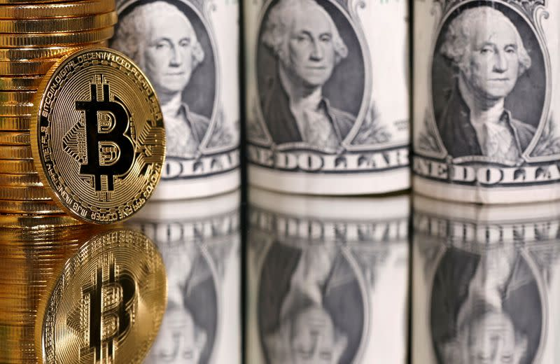 FILE PHOTO: Representations of bitcoin and U.S. dollar banknotes are seen in this illustration