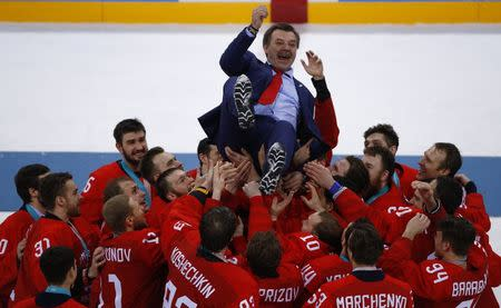 Ice Hockey - Pyeongchang 2018 Winter Olympics - Men Final Match - Olympic Athletes from Russia v Germany - Gangneung Hockey Centre, Gangneung, South Korea - February 25, 2018 - Olympic Athlete from Russia coach Oleg Znarok is lifted up. REUTERS/Brian Snyder