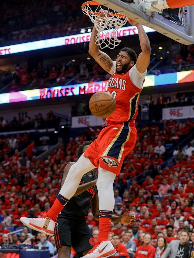 Apr 19, 2018; New Orleans, LA, USA; New Orleans Pelicans forward Anthony Davis (23) dunks over Portland Trail Blazers forward Al-Farouq Aminu (8) during the second quarter in game three of the first round of the 2018 NBA Playoffs at the Smoothie King Center. Mandatory Credit: Derick E. Hingle-USA TODAY Sports TPX IMAGES OF THE DAY