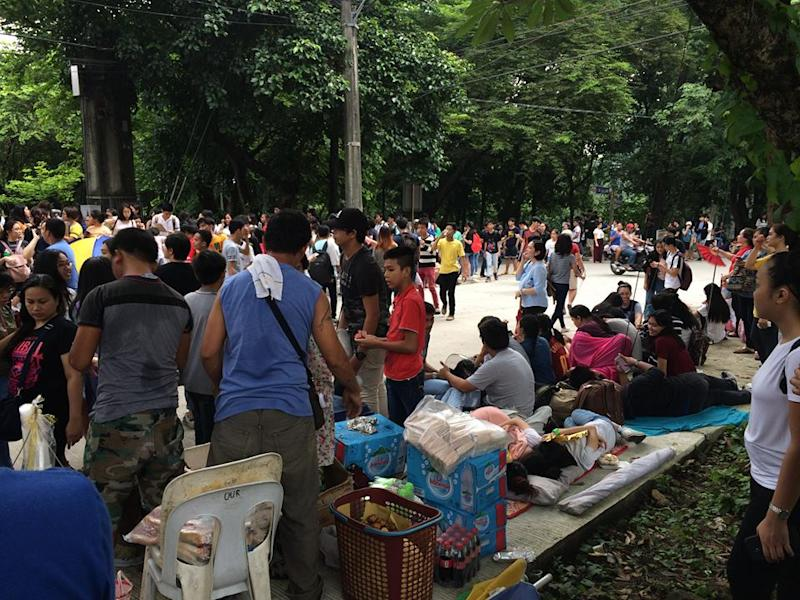 Students, parents camp out to submit University of the Philippines