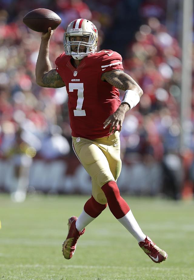 San Francisco 49ers quarterback Colin Kaepernick (7) passes against the Green Bay Packers during the third quarter of an NFL football game in San Francisco, Sunday, Sept. 8, 2013. (AP Photo/Marcio Jose Sanchez)