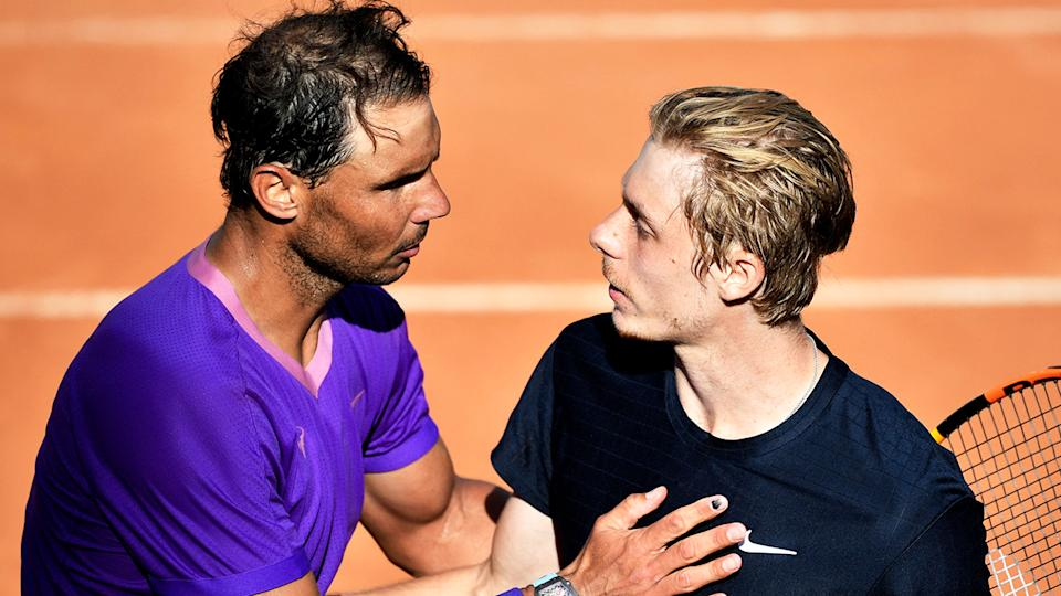 Rafael Nadal (pictured left) greets Denis Shapovalov (pictured right) at net after his victory.