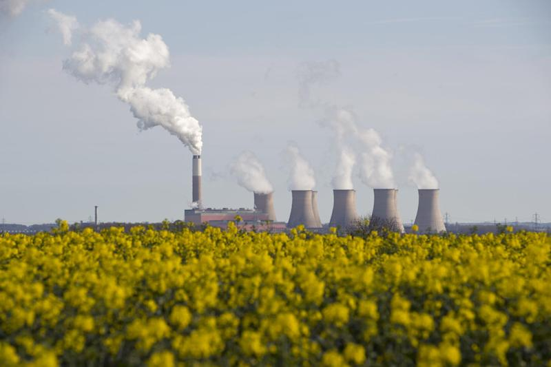 Smoke rises from the cooling towers of Cottam coal-fired power station, near Darlton, Nottinghamshire: AFP/Getty