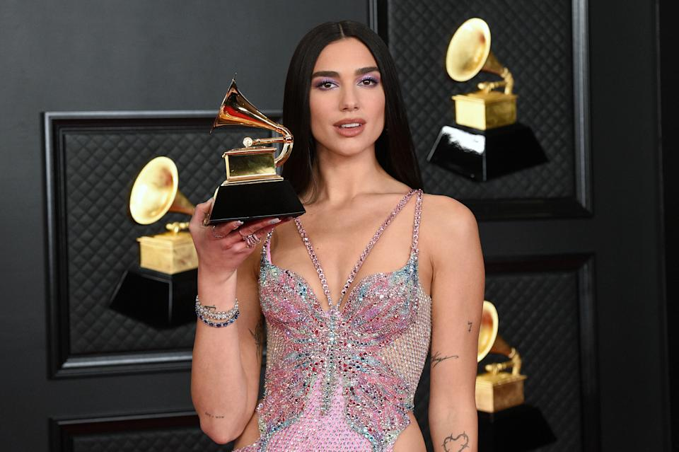 LOS ANGELES, CALIFORNIA - MARCH 14: Dua Lipa, winner of Best Pop Vocal Album for 'Future Nostalgia', poses in the media room during the 63rd Annual GRAMMY Awards at Los Angeles Convention Center on March 14, 2021 in Los Angeles, California. (Photo by Kevin Mazur/Getty Images for The Recording Academy )