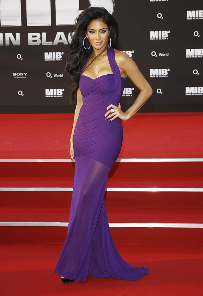 "Meanwhile, in Germany -- at the Berlin premiere of <a target=""_blank"" href=""http://movies.yahoo.com/movie/men-in-black-iii-2012/"">""Men In Black 3""</a> -- former Pussycat Doll Nicole Scherzinger turned heads in what may be her best look yet. What do you make of the ex ""X Factor"" judges' purple Herve Leroux bandage dress, which featured a halter neck and sheer skirt? Hot or not? (5/14/2012)"
