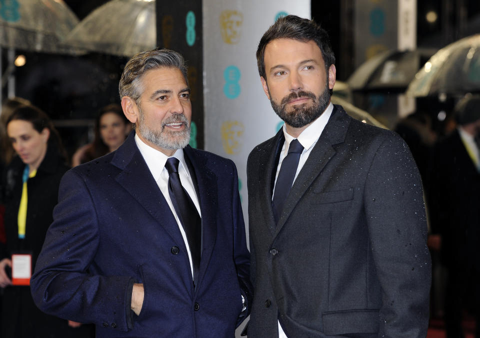 George Clooney, left, and Ben Affleck seen arriving for the BAFTA Film Awards at the Royal Opera House on Sunday, Feb. 10, 2013, in London. (Photo by Jonathan Short/Invision/AP)