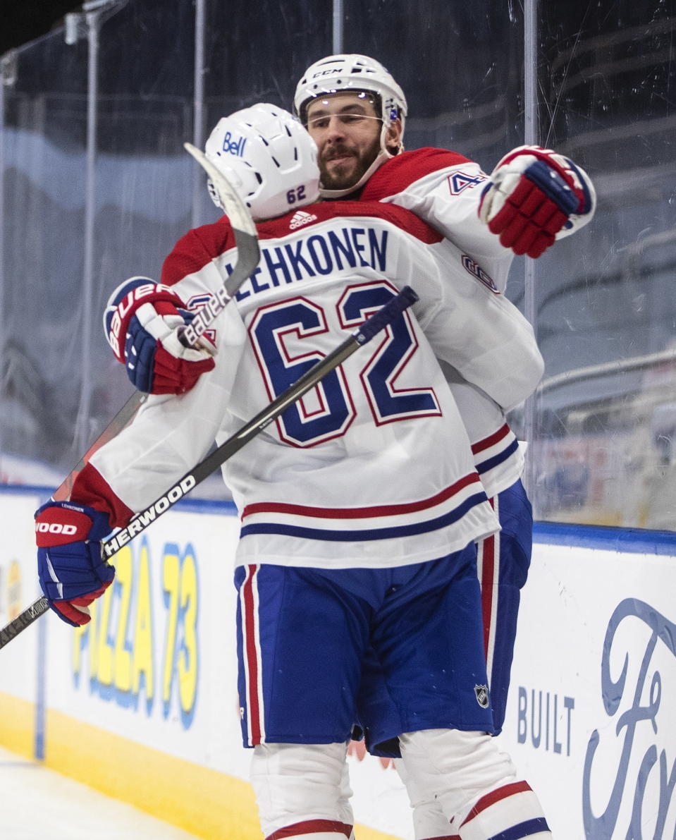 Montreal Canadiens' Artturi Lehkonen (62) and Joel Edmundson (44) celebrate a goal against the Edmonton Oilers during third-period NHL hockey game action in Edmonton, Alberta, Monday, Jan. 18, 2021. (Jason Franson/The Canadian Press via AP)